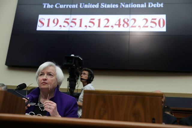 As the number of the current U.S. national debt is seen on a screen, Federal Reserve Board Chair Janet Yellen testifies during a hearing before the House Financial Services Committee September 28, 2016