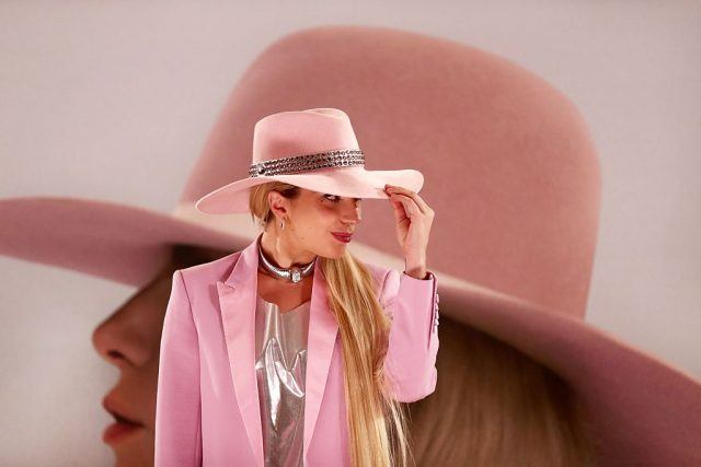Lady Gaga poses for Joanne in a pink suit and hat