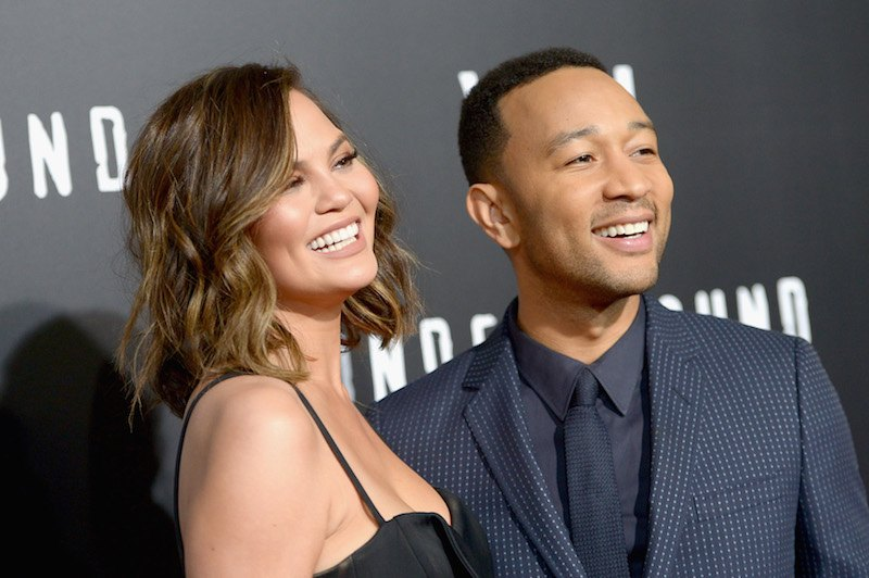 """Model Chrissy Teigen (L) and actor/singer/executive producer John Legend attend WGN America's """"Underground"""" Season Two Premiere"""