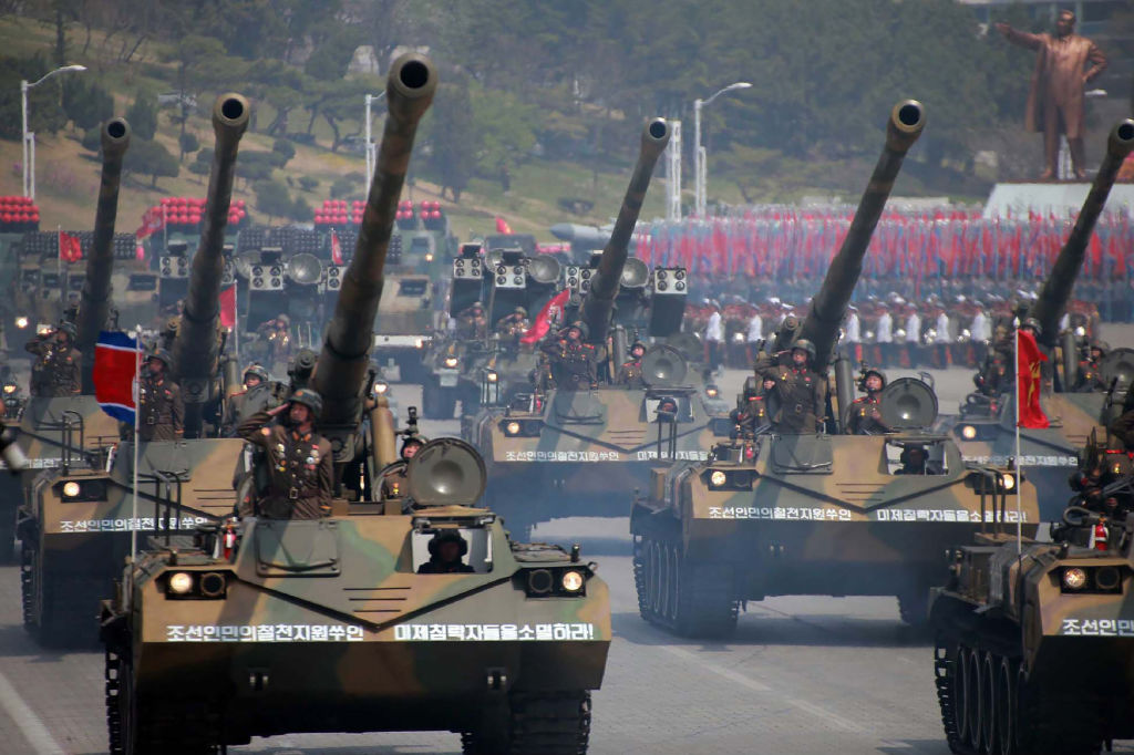 Korean People's howitzers being displayed through Kim Il-Sung square during a military parade in Pyongyang