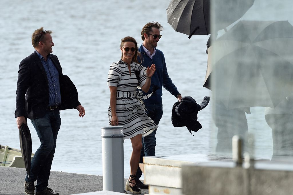 Pippa Middleton (C) and her husband James Matthews (R) arrive at Rose Bay Wharf by sea plane in Sydney on May 31, 2017 for their honeymoon.