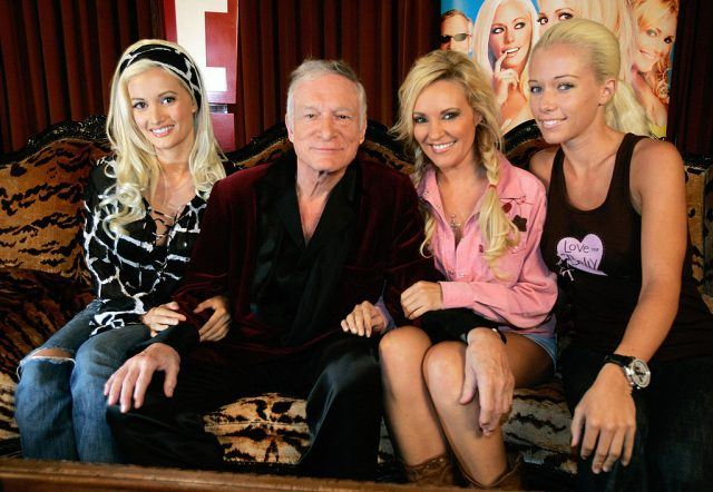 Hugh Hefner, CEO of Playboy Enterprises, poses for a photo with his three girlfriends, Holly (L), Bridget (2R) and Kendra (R) during an interview with journalists at his mansion in Los Angeles, CA 23 August 2006.