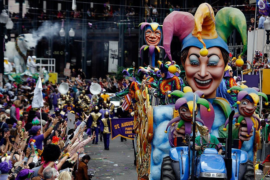 Floats in the Rex parade roll along St. Charles avenue on Mardi Gras in New Orleans, Louisiana.