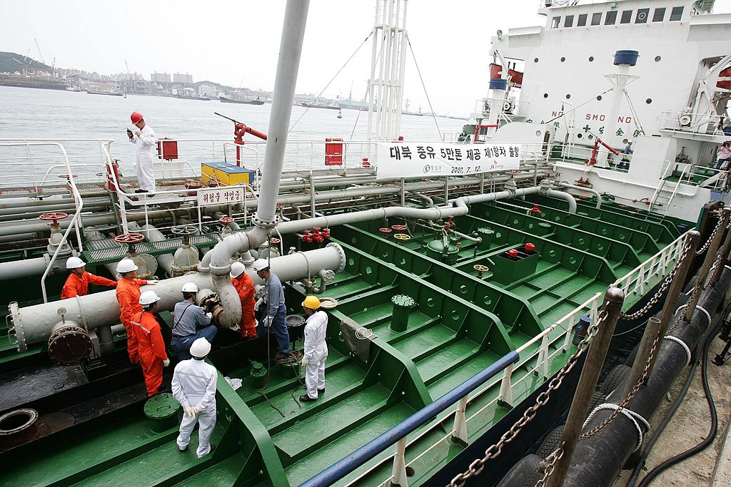 Korean workers fill an oil tanker