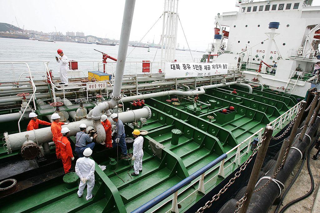 Korean workers fill an oil tanker