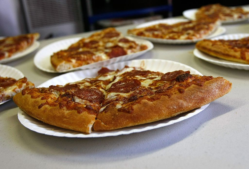 slices of pizza on plates