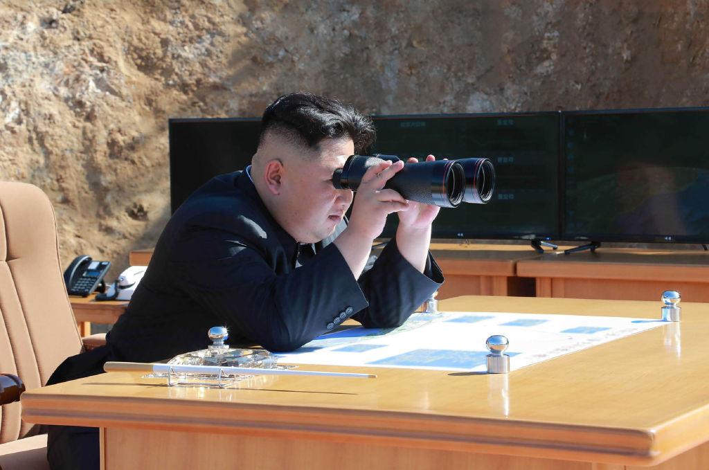 Kim Jong-un with binoculars