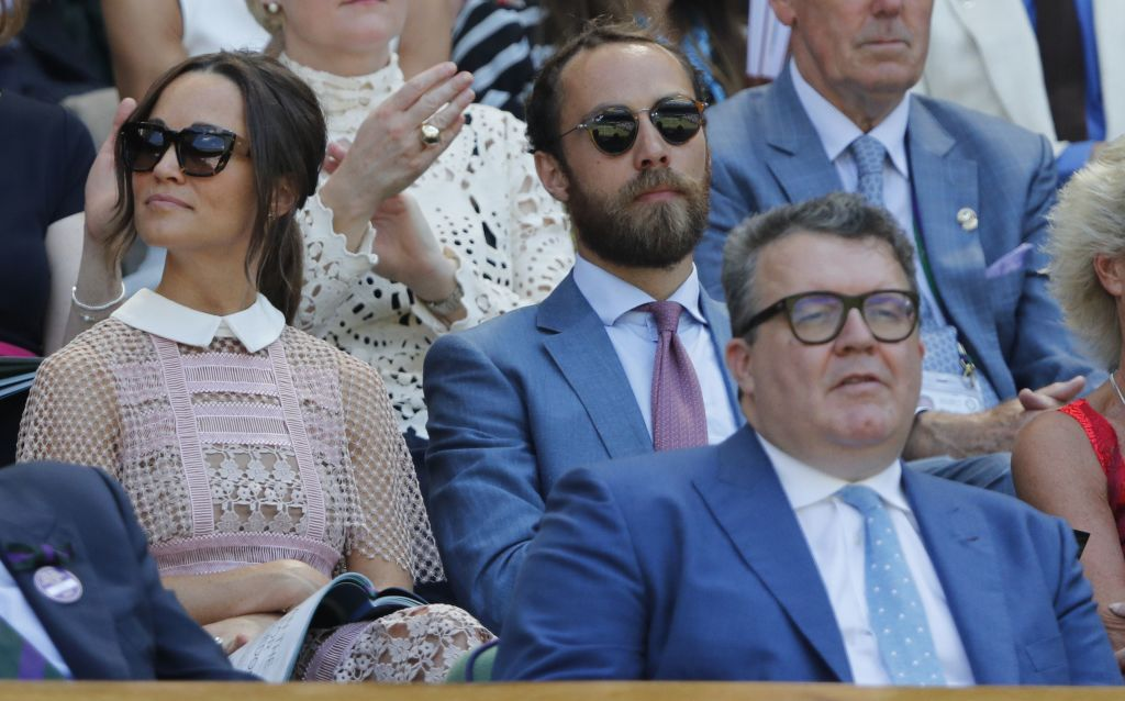 Pippa Middleton (L), and James Middleton (C) watch the play on Centre Court at The All England Lawn Tennis Club in Wimbledon, southwest London, on July 5, 2017 on the third day of the 2017 Wimbledon Championships.