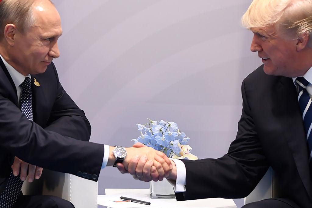 Trump shakes hands with Putin