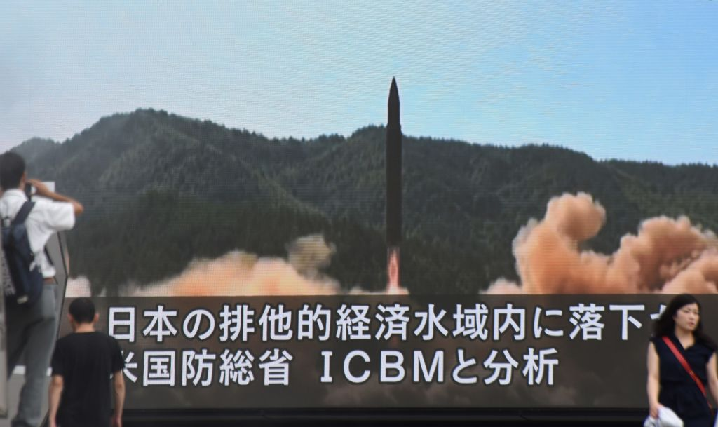 A screen broadcasts a missile test