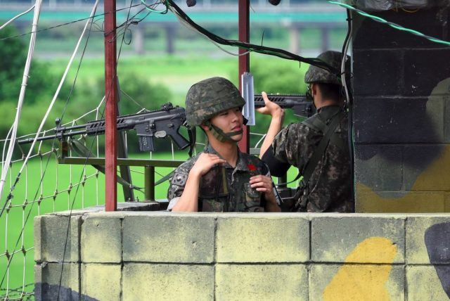 South Korean soldiers stand guard at a guard post near the Demilitarized Zone (DMZ) dividing two Koreas in the border city of Paju on August 11, 2017