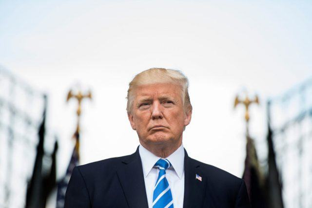 Donald Trump standing and looking forward.