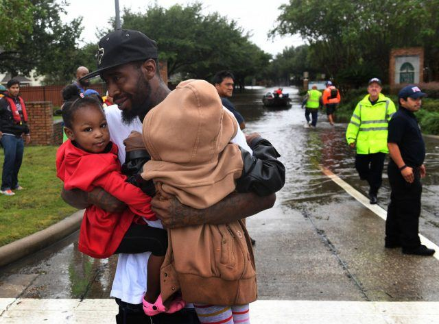 A father is reunited with his children who were evacuated in the Clodine district after Hurricane Harvey