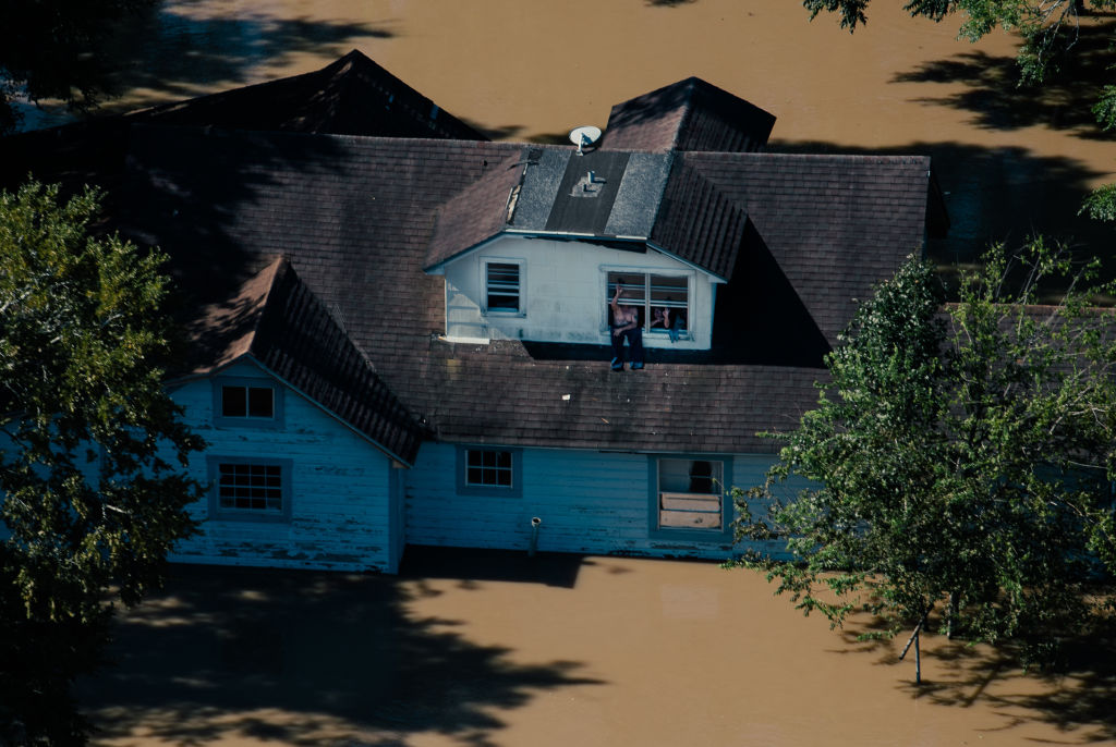This picture shows an aerial view of a home that has been flooded in Houston