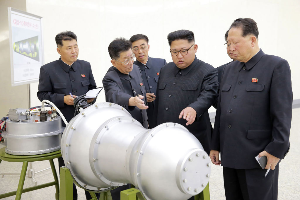 Kim Jong-un inspects a weapon