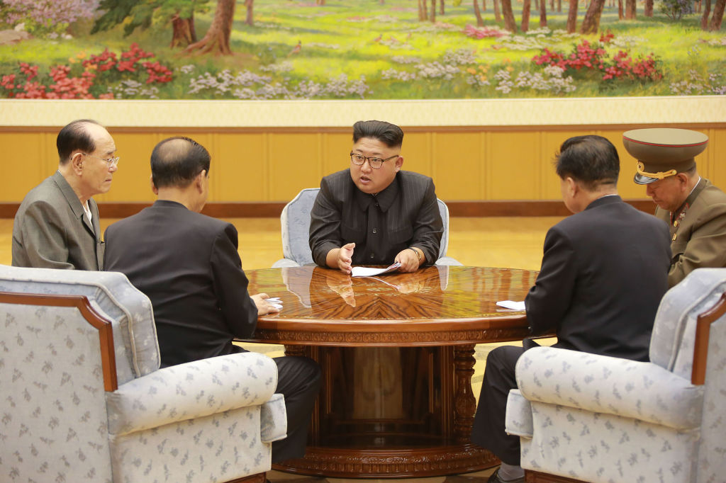 This picture taken on September 3, 2017 and released by North Korea's official Korean Central News Agency (KCNA) on September 4, 2017 shows North Korean leader Kim Jong-Un attending a meeting with a committee of the Workers' Party of Korea about the test of a hydrogen bomb, at an unknown location.