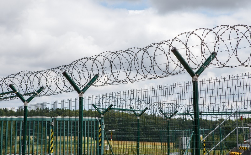 Security fence with barbed wire