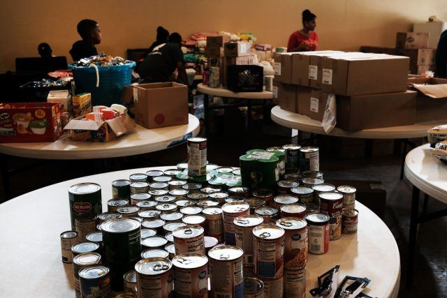 Cans of food are displayed on a table at a church that is now a relief center for flood victims in Orange as Texas slowly moves toward recovery from the devastation of Hurricane Harvey