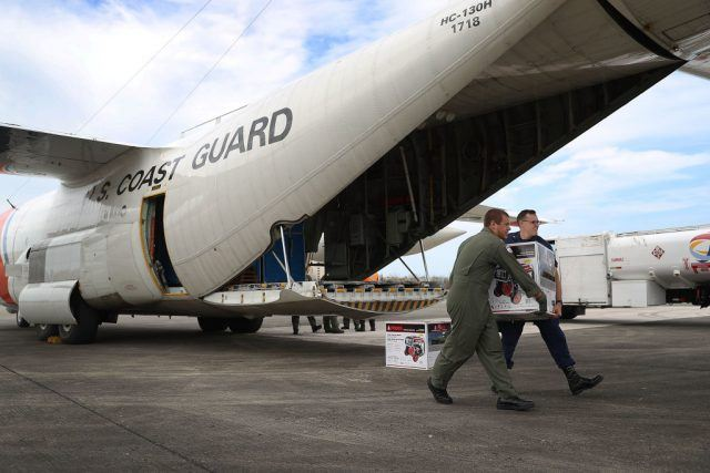 Coast Guard plane with supplies