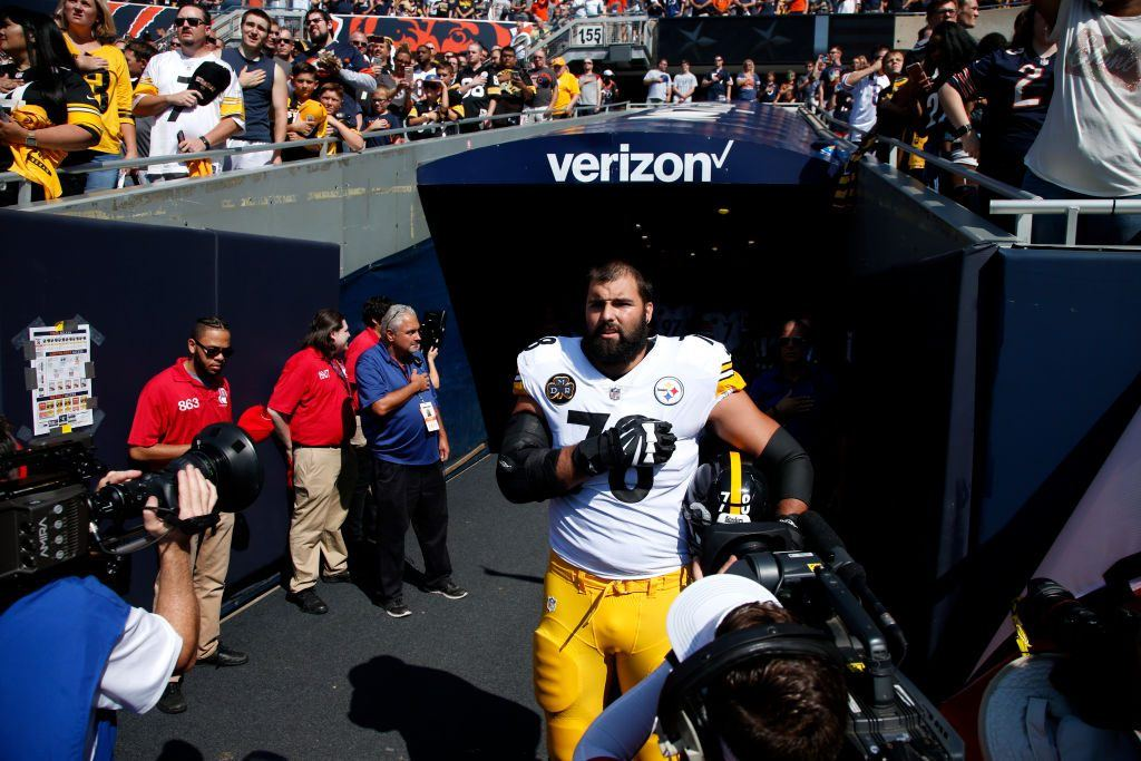 Alejandro Villanueva #78 of the Pittsburgh Steelers stands by himself in the tunnel for the national anthem.