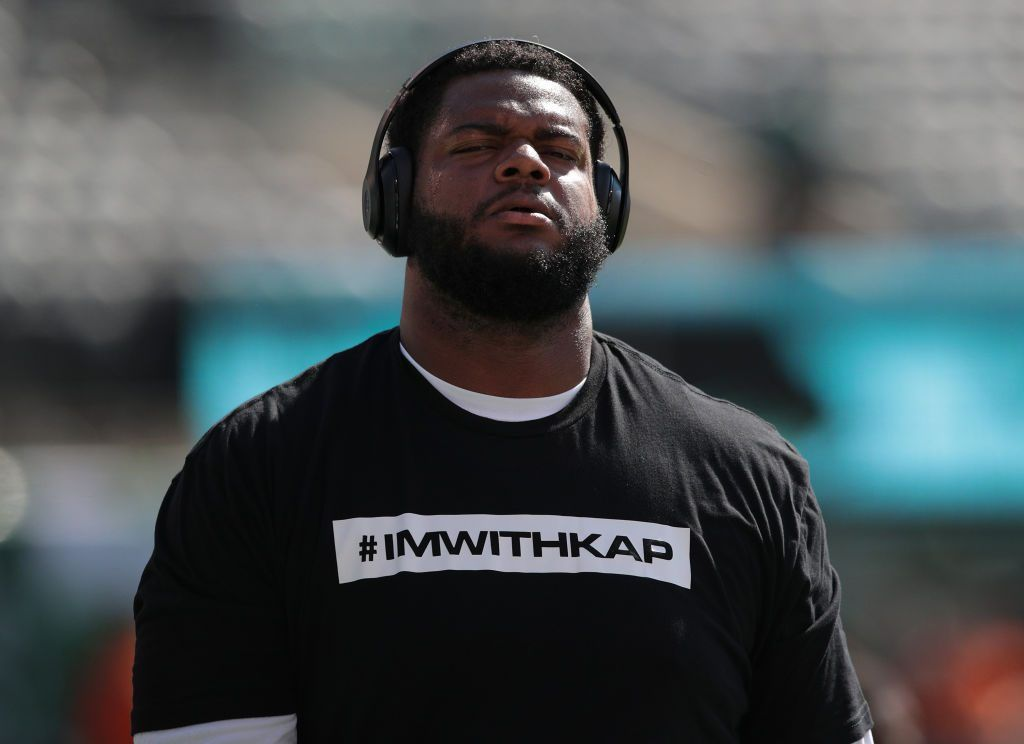 Jordan Phillips #97 of the Miami Dolphins wears a t-shirt in support of former quarterback Colin Kaepernick before a game against the New York Jets at MetLife Stadium on September 24, 2017 in East Rutherford, New Jersey.