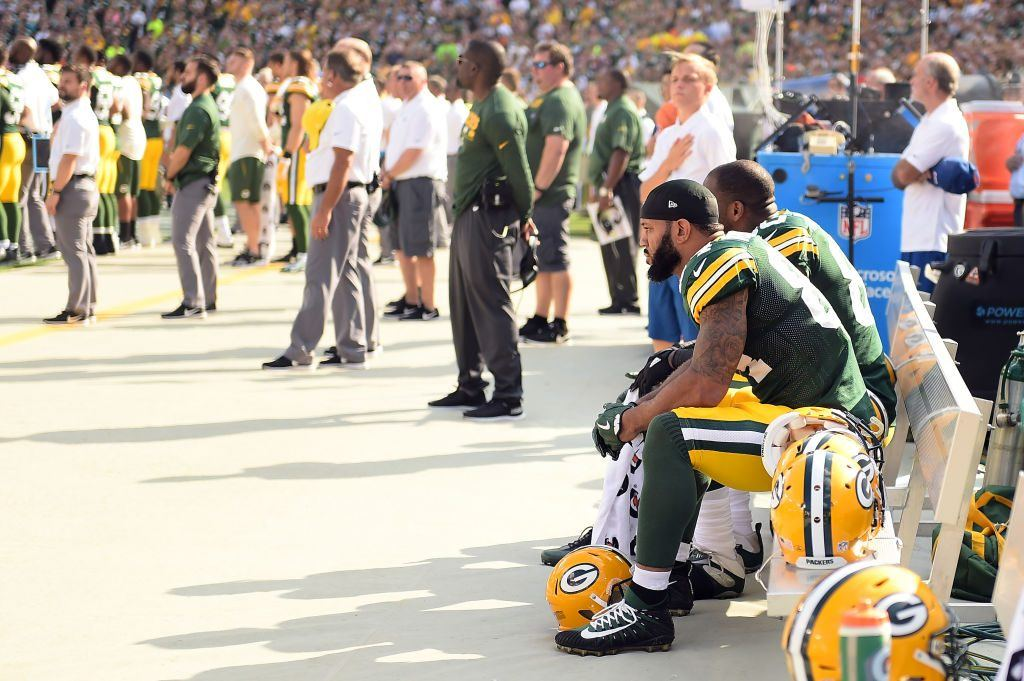 Green Bay Packers players sit in protest during the national anthem prior to the game against the Cincinnati Bengals at Lambeau Field on September 24, 2017 in Green Bay, Wisconsin.