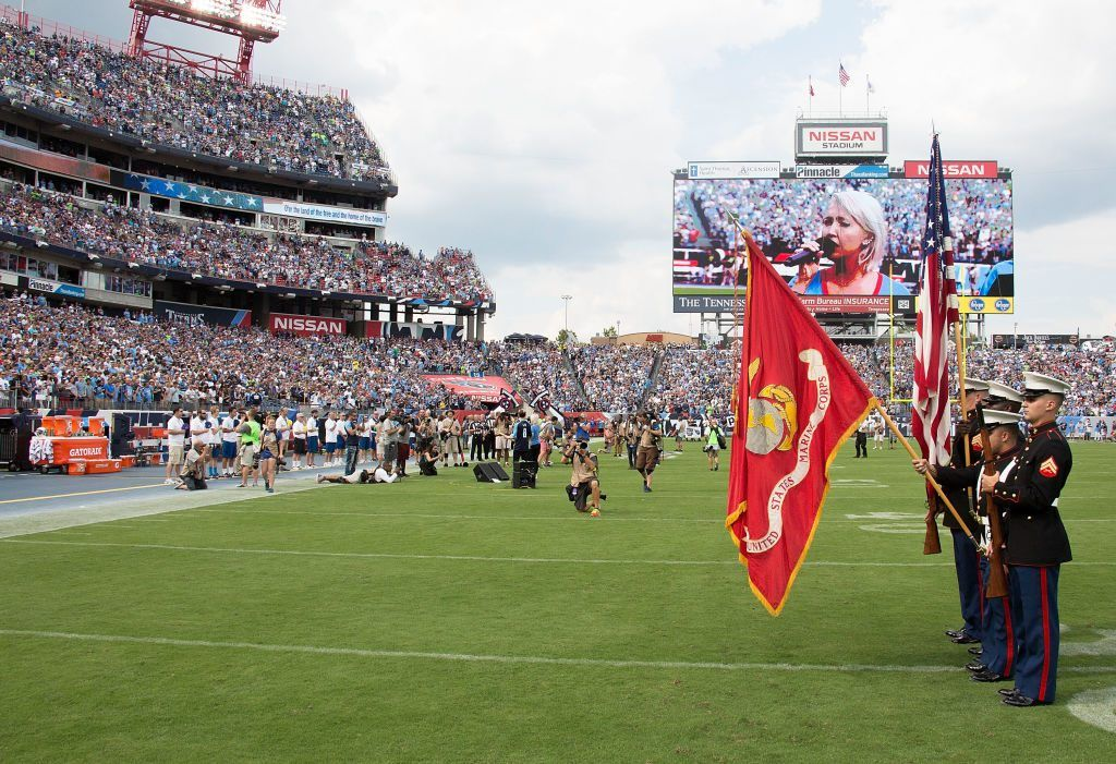 The colorguard presents the American Flag as the bench of the Tennessee Titans remains empty during the national anthem prior to a game between the Tennessee Titans and the Seattle Seahawks at Nissan Stadium on September 24, 2017 in Nashville, Tennessee.