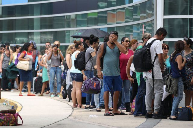 people waiting at an airport in Puerto Rico