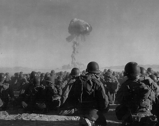 Soldiers watch atomic bomb