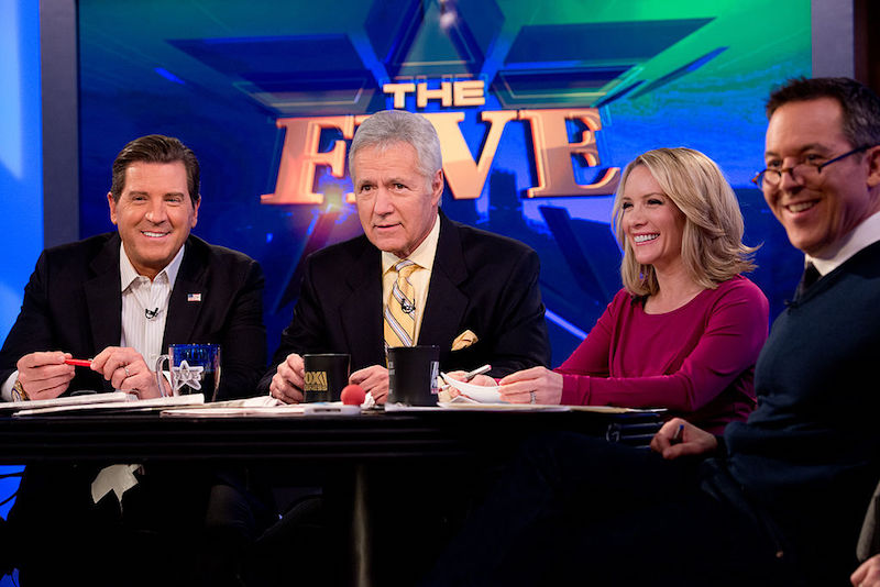 TV personality Alex Trebek (3rd R) and hosts of 'The Five' (L-R) Eric Bolling, Dana Perino and Greg Gutfeld attend FOX News' 'The Five' at FOX Studios on February 26, 2014 in New York City. | Noam Galai/Getty Images
