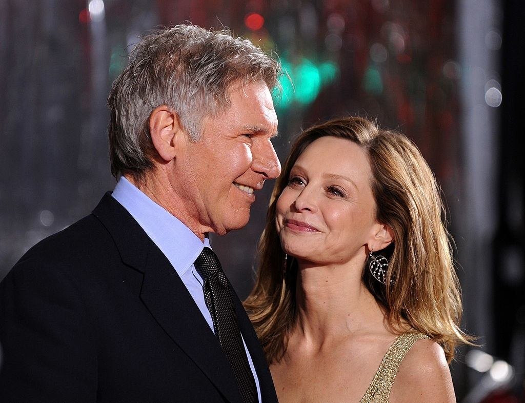Harrison Ford and Calista Flockhart arrive at a movie premiere.