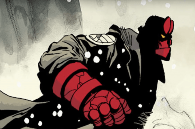 Hellboy running in the snow wearing a jacket.
