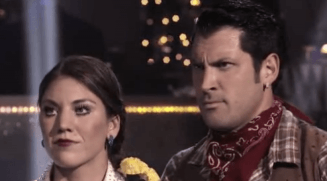 Maksim Chmerkovskiy and Hope Solo stand together while hearing the judges score their dance routine.