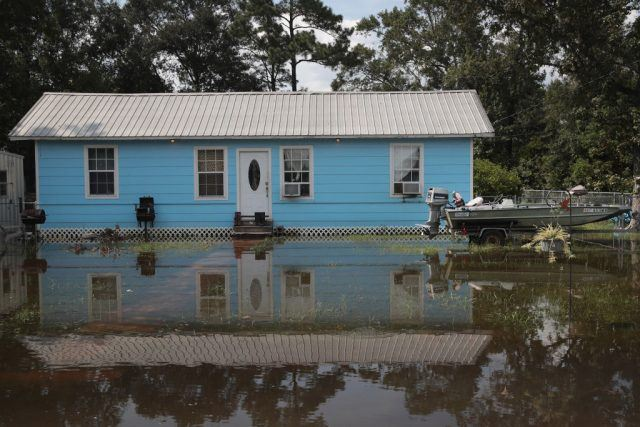 Floodwater surrounds a home after Hurricane Harvey