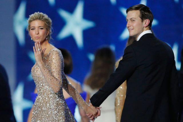 Ivanka Trump and Jared Kushner holding hands while walking across a stage.
