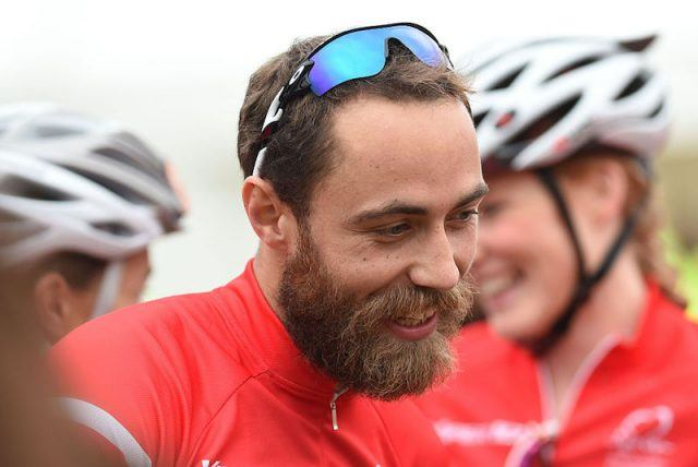 James Middleton riding a bike at a charity event in London.