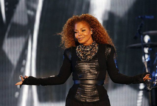 Janet Jackson performs in Dubai in a black dress.