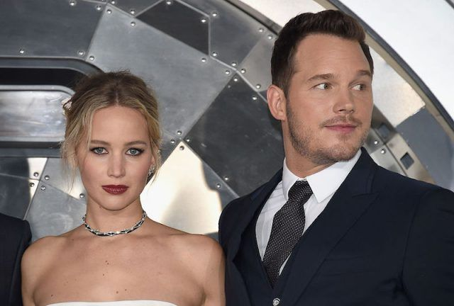 Jennifer Lawrence and Chris Pratt stand next to each other at a movie premiere.