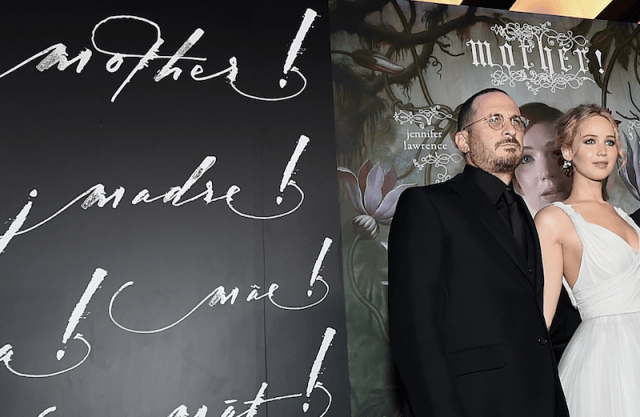 Jennifer Lawrence and Darren Aronofsky stands together at the red carpet of the movie's premiere.