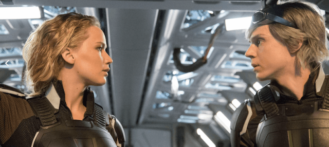 Jennifer Lawrence looking at another character with a serious expression on her face.