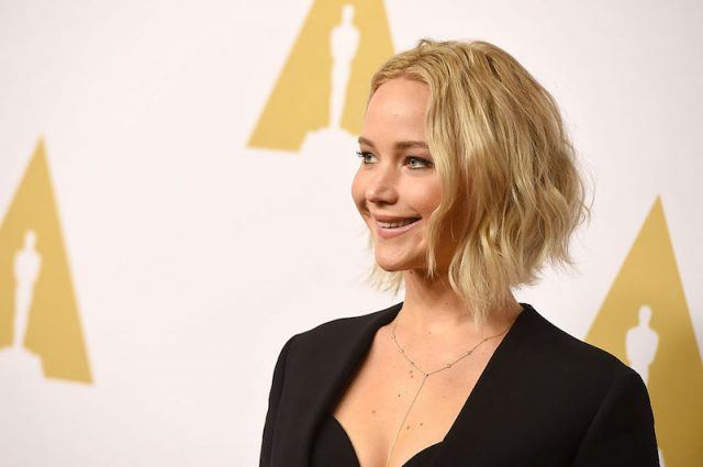 Jennifer Lawrence smiles at the Academy Awards.