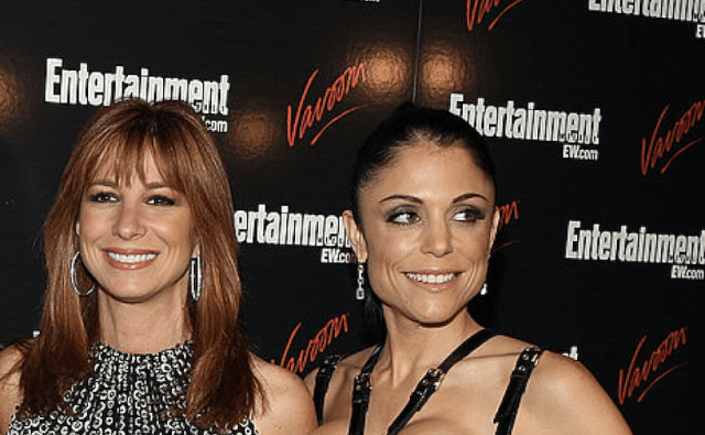 Jill Zarin & Bethenny Frankel stand together at a press event.