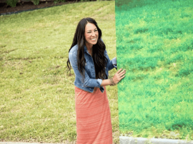 Joanna Gaines holding up a board.