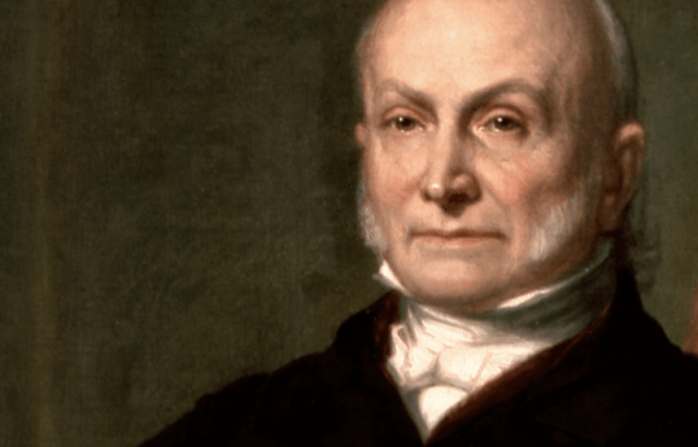 John Quincy Adams standing in front of a dark background.
