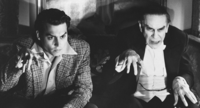 A black and white photo of Johnny Depp holding out his hand in 'Ed Wood'.