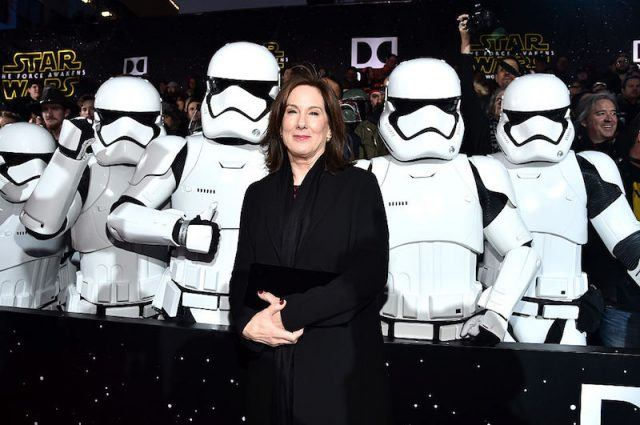Kathleen Kennedy poses in front of a group of stormtroopers at the premiere of 'Star Wars: The Force Awakens'.