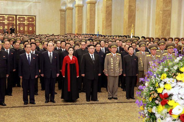 Kim Jong II stands with his wife during a ceremony.
