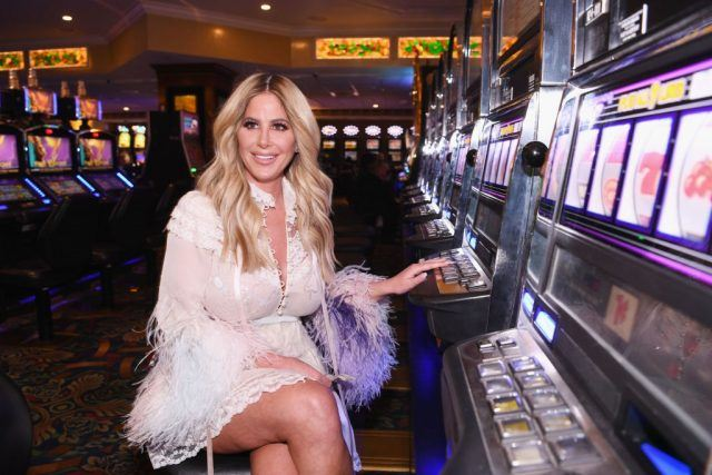 Kim Zolciak-Biermann sitting in front of slots.