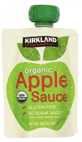 A squeeze tube of organic apple sauce.
