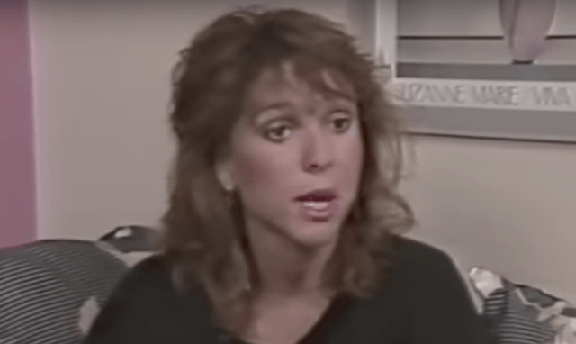 Kristy McNichol appears in an interview while sitting on a couch.